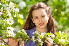 Attractive teenager girl with white pear flowers Stock Image