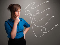 Attractive teenager looking at multiple curly arrows Stock Images