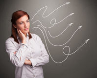 Attractive teenager looking at multiple curly arrows Stock Image