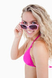 Attractive teenager looking over her sunglasses Royalty Free Stock Photo