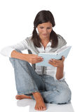 Attractive teenager reading book. On white background Royalty Free Stock Photo