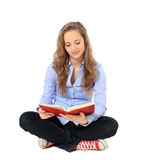 Attractive teenager reading a book Stock Photos