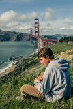 Attractive Teenager in San Francisco with Golden Gate Bridge Royalty Free Stock Photography