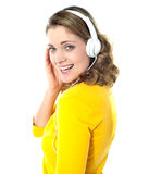 Attractive teenager tuned into music Royalty Free Stock Photos