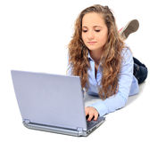 Attractive teenager using laptop Stock Photo