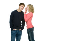 Attractive teenagers gossiping and flirting. Attractive teenagers standing next to eachother gossiping and flirting Royalty Free Stock Photos
