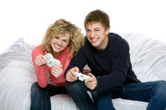 Attractive teenagers playing video games royalty free stock image
