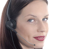 Telephone worker, phone headset, microphone, looking at camera, close up, white background. Attractive office worker using a telephone headset royalty free stock images