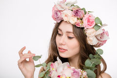 Attractive tender female in rose wreath with bouquette of flowers Royalty Free Stock Photography