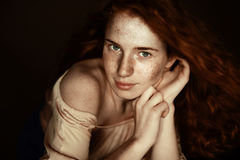 Attractive tender freckled redhead woman looking at camera Stock Image