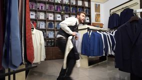 Attractive thief in the menswear store stock video footage