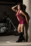 Attractive thirties asian woman riding motorcycle Royalty Free Stock Photos
