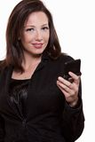Attractive thirties caucasian businesswoman. Using pager/text messaging Stock Photos