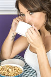 Attractive Thoughtful Annoyed Young Woman Having Breakfast Drinking Coffee Stock Photos