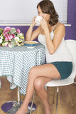 Attractive Thoughtful Annoyed Young Woman Having Breakfast Drinking Coffee Stock Images