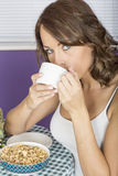 Attractive Thoughtful Annoyed Young Woman Having Breakfast Drinking Coffee Stock Photo