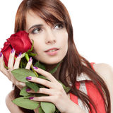Attractive thoughtful girl holding red roses Royalty Free Stock Photos