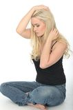 Attractive Thoughtful Unhappy Young Woman Sitting on the Floor Stock Photos