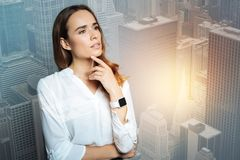 Attractive thoughtful woman holding her chin royalty free stock photo