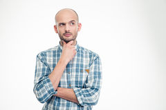 Attractive thoughtful young man in plaid shirt looking away Royalty Free Stock Image