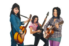 Attractive three women with guitars Royalty Free Stock Photography