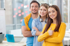 Attractive three workers are expressing positive royalty free stock photos