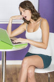 Attractive Tired Bored Yawning Young Woman Using Laptop Computer Royalty Free Stock Photography