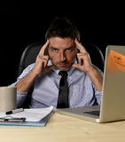 Attractive tired businessman in shirt and tie tired overwhelmed heavy work load exhausted at office Stock Photo