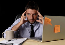 Attractive tired businessman in shirt and tie tired overwhelmed heavy work load exhausted at office Stock Photos