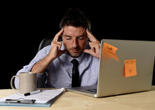 Attractive tired businessman in shirt and tie tired overwhelmed heavy work load exhausted at office Royalty Free Stock Images