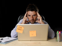 Attractive tired businessman tired overwhelmed heavy work load exhausted at office Royalty Free Stock Images