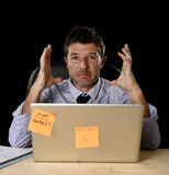 Attractive tired businessman tired overwhelmed heavy work load exhausted at office Stock Images