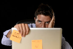 Attractive tired businessman tired overwhelmed heavy work load exhausted at office Royalty Free Stock Photos
