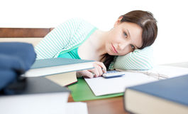 Attractive tired woman studying on a table Royalty Free Stock Photography
