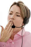 Attractive Tired Young Business Woman Using a Telephone Headset Stock Image