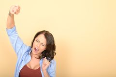 Attractive Tired Young Woman Yawning and Stretching Stock Image