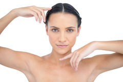 Attractive topless model gesturing. On white background Stock Photo