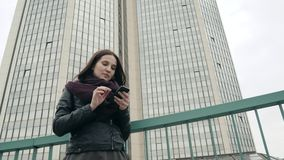 Attractive Tourist Dressed In Casual Wear Using Application On Smartphone For Navigating In Town, Hipster Girl Standing. On Urban Setting Promotional Background stock video footage