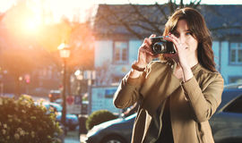 Attractive Tourist taking a photograph with vintage camera Royalty Free Stock Photo
