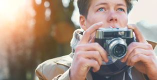 Attractive Tourist taking a photograph with vintage camera Stock Images