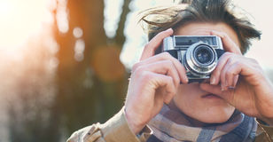 Attractive Tourist taking a photograph with vintage camera Stock Photography