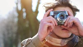 Attractive Tourist taking a photograph with vintage camera stock video