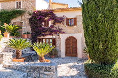 Attractive Town House, Pollensa, Mallorca. An attractive town house on the Calle de Calvari in Pollensa with beautiful palms and bougainvillea in the front Stock Image