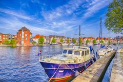 Attractive Travel Boat On Channel At Pier of Harlem City Stock Images