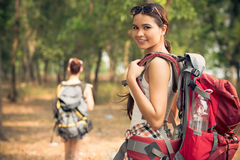 Attractive traveler. Close-up portrait of a lovely traveler looking at camera on the foreground Royalty Free Stock Photos