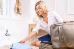Attractive traveller unpacking her stuff Royalty Free Stock Photo