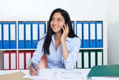 Attractive turkish businesswoman with phone at office stock photos