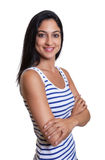Attractive turkish woman with crossed arms in a striped shirt. On an isolated white background for cut out Stock Images