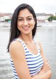 Attractive turkish woman at the sea looking at camera Royalty Free Stock Photos