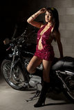 Attractive twenties asian woman riding motorcycle Royalty Free Stock Image
